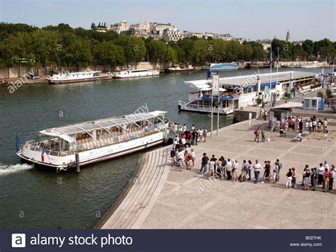 bateau mouche paris france the queue for the bateaux mouches on the river seine in