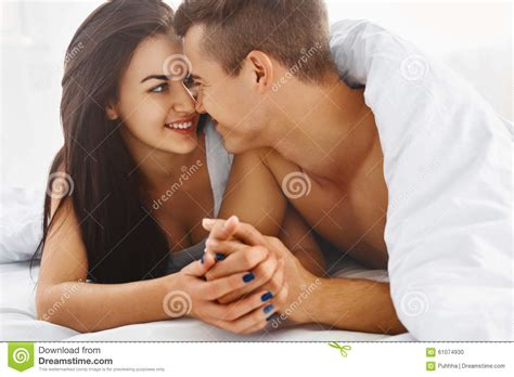 romantic couple in bed images close up portrait of romantic couple in bed stock photo
