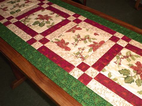 google christmas tree shop kitchen table runners not xmas patchwork mill bright poinsettia table runner and table topper for