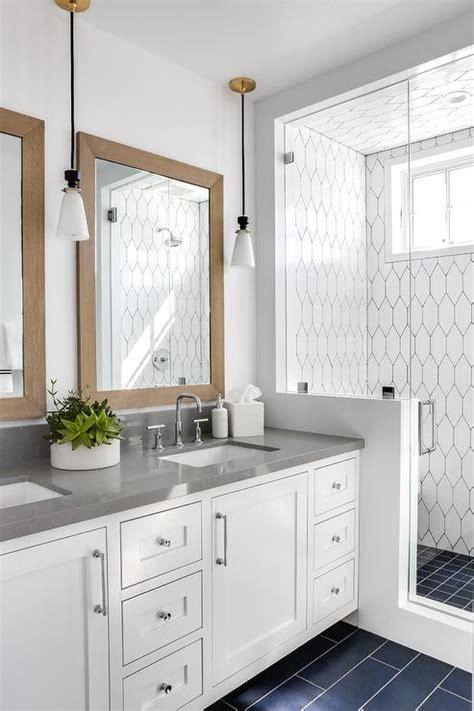 Light Blue Washstand with Gray Glass Backsplash Tiles