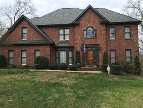 What Color Should I Paint My Shutters trim color for red brick with light grey roof