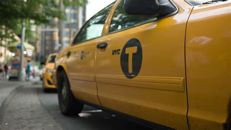 new york july 3 2014 opens door of yellow taxi