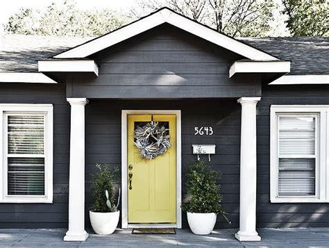 gray house yellow door articles vickery place dallas texas
