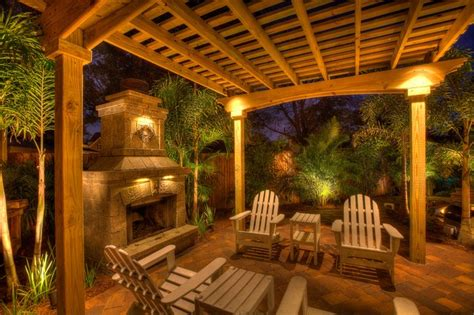 Fireplace with Pergola Tropical Patio tampa by Landscape Fusion