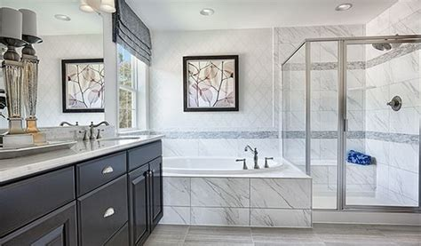 bathrooms stafford with a glass enclosed shower soaking tub and elegant
