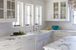 calcutta gold marble kitchen countertops with white subway