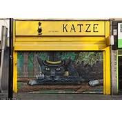 Graffiti Artists Decorate Drab Shutters In Bristol With