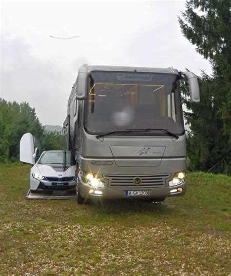 volkner rv this 1 7 million motorhome with its own garage may look like an ordinary bus from outside but
