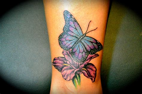 flower leg tattoo butterfly and flower on leg