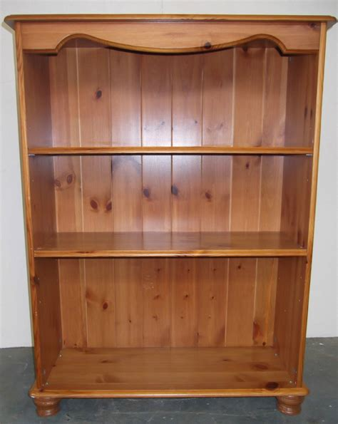 solid pine bookcase with two three shelves and four