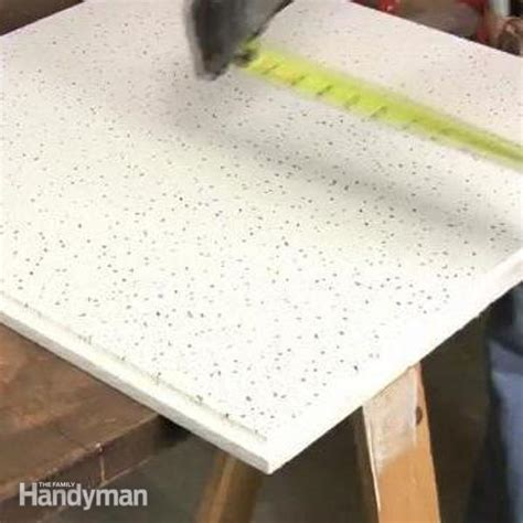 how to cut ceiling tiles the family handyman