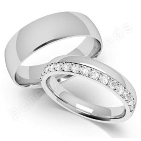 spotlight on his hers wedding rings white gold