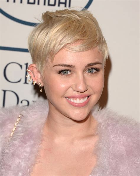1000 images about new hair on pinterest miley cyrus miley cyrus debuts a cool bleached pixie cut elle canada