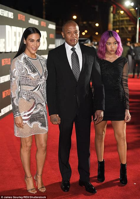 rap producer dr dre s wife nicole black and famous dr dre makes a rare red carpet appearance with wife and