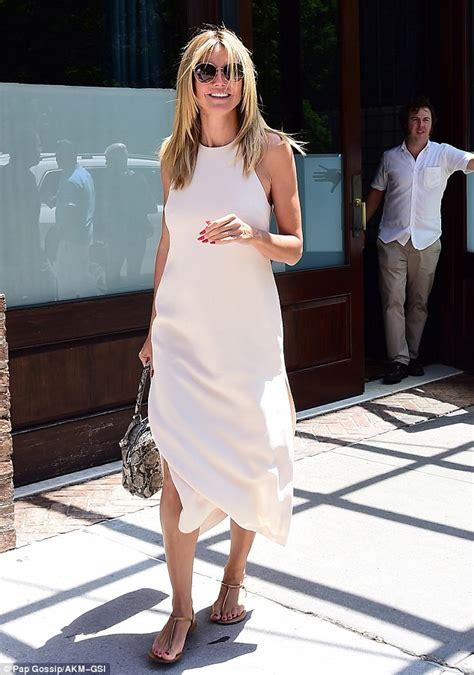 Maxi Leni heidi klum looks angelic in sleeveless white maxi dress