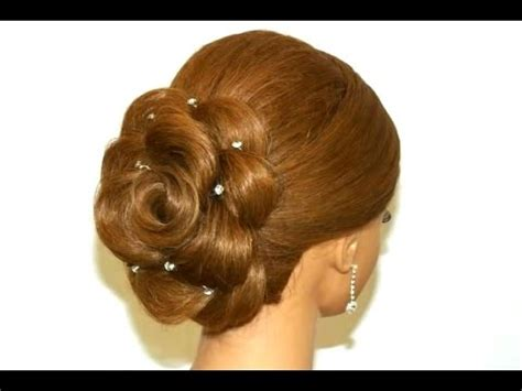 Wedding hairstyle for long hair. Hair made rose. Updo