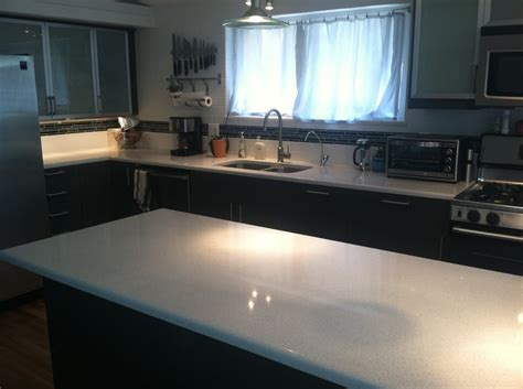 ikea kitchen with white quartz countertops subway tile