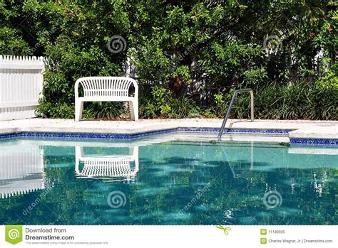 swimming pool bench white bench by swimming pool royalty free stock photo