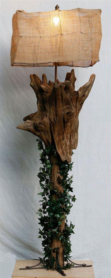 lamparas hechas  ramas de arbol