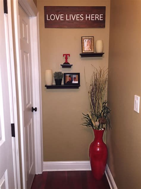 cute idea to decorate the end of a hallway floating shelves large vase picture frames and