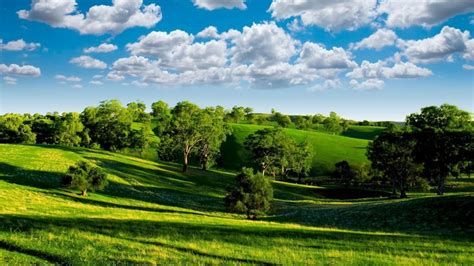 green valley nature scenery blue sky white clouds