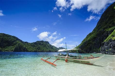 Photo Wall Murals Uk outrigger boat in the crystal clear water in the bacuit