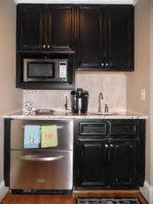 How To Finish Kitchen Cabinets by Vintage Onyx Distressed Finish Kitchen Cabinets