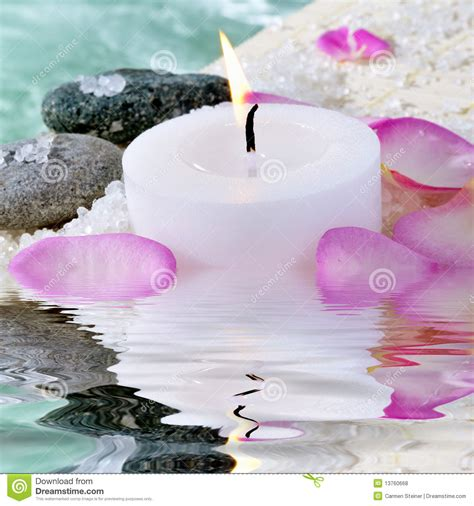 sti per candele candle stones and petals royalty free stock photos