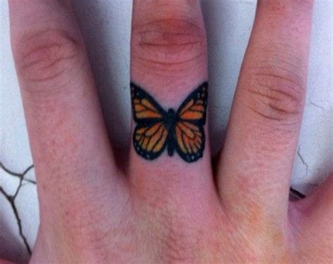 butterfly knuckle tattoo butterfly finger tattoo i would totally get this on the