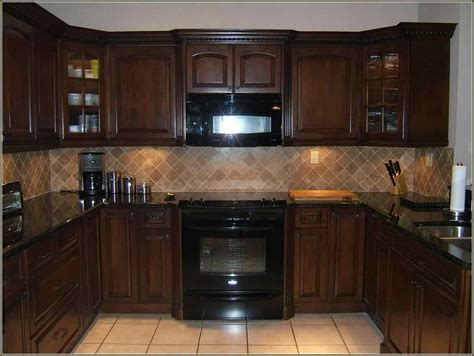 kitchen with brown cabinets dark brown kitchen cabinets with black appliances