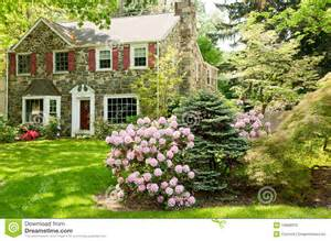 Small House Plans With Porches family house with beautiful front lawn in spring stock