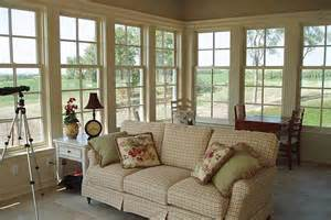 The lovely sunroom features many details in the woodwork and trim