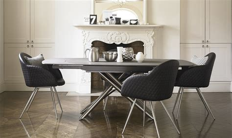 extending large grey effect glass dining table and terso swivel extending dining table 4 black faux leather chairs grey granite effect glass