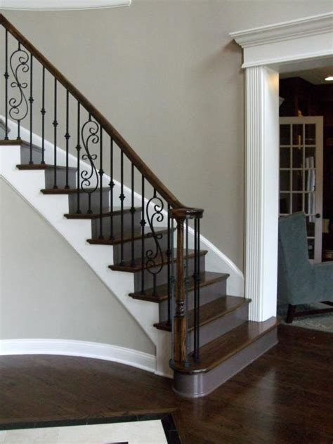 iron banisters and railings iron and wood curved staircase