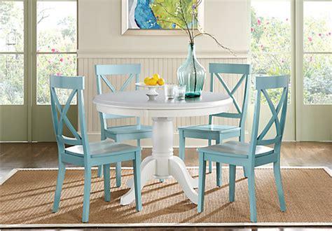 brynwood white  pc pedestal dining set blue chairs
