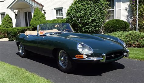 Car Types Beginning With E by 1964 Jaguar E Type Convertible In Green With Engine Start