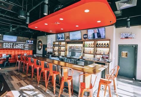 east coast bar stool east coast wings grill inks franchise agreement in north