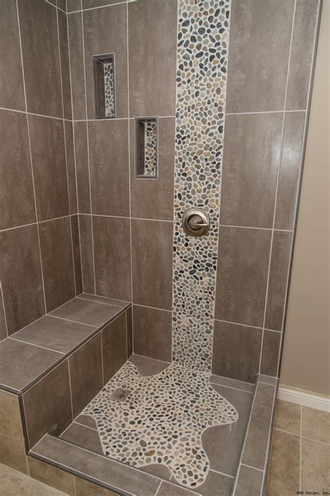 tile by design spruce up your shower by adding pebble tile accents click