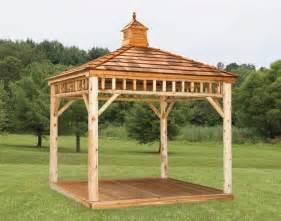 This raw wood log cabin style gazebo has an open design that s perfect
