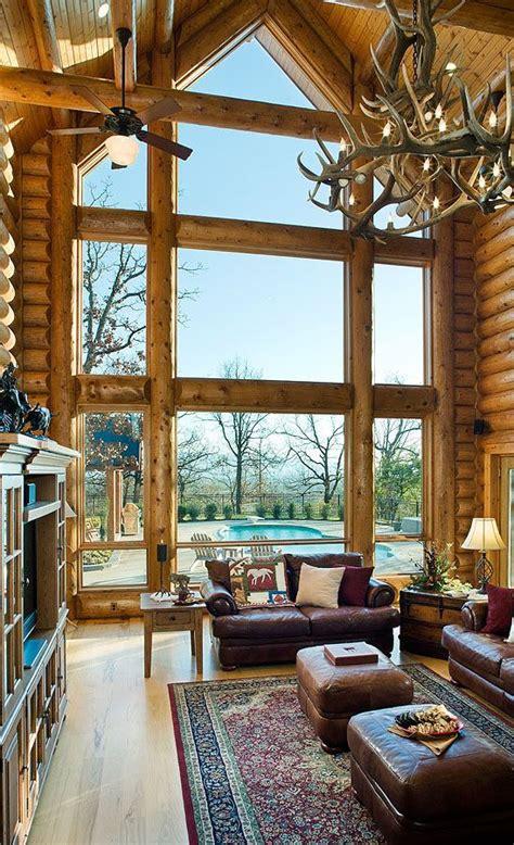 log home great room  stunning windows log homes