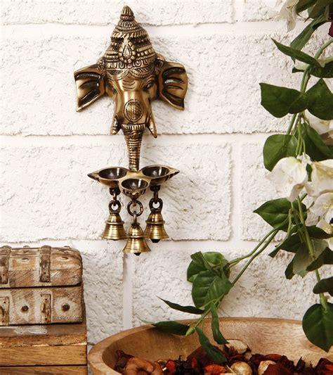 brass ganesha wall hanging diya  bells diyas india