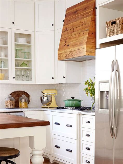 white symmetrical kitchen range with natural wooden bhg style spotters