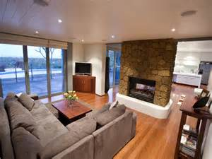 Outdoor Double Sided Fireplace - open plan living room using brown colours with floorboards amp fireplace living area photo 297128