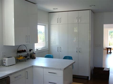 hidden laundry cabinets at end of kitchen
