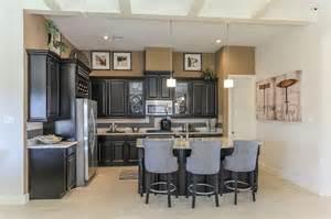 gehan homes kitchen black cabinets grey shairs