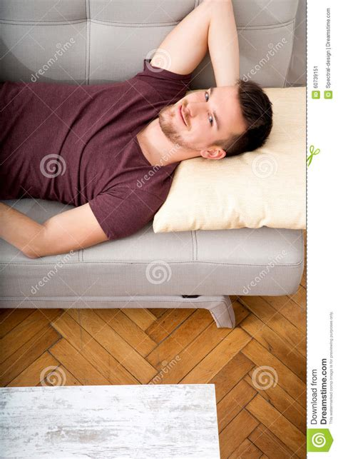 lying on the couch young man lying on the sofa stock photo image 60739151