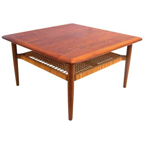 modern 1950s square coffee table with caned shelf
