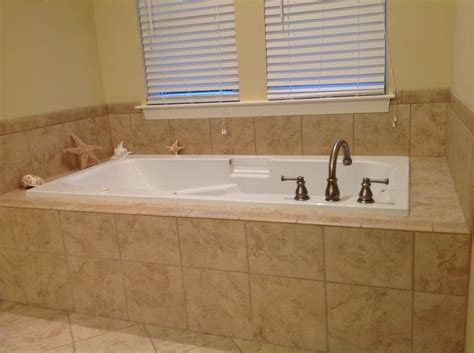 deep jetted tub with tile surround me pinterest