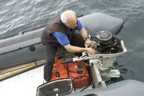 boat engine working file engineer person working on boat engine jpg