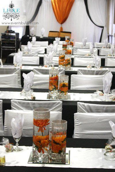 Orange, black and white wedding centerpieces and reception